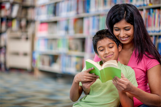 Mother and son reading in library